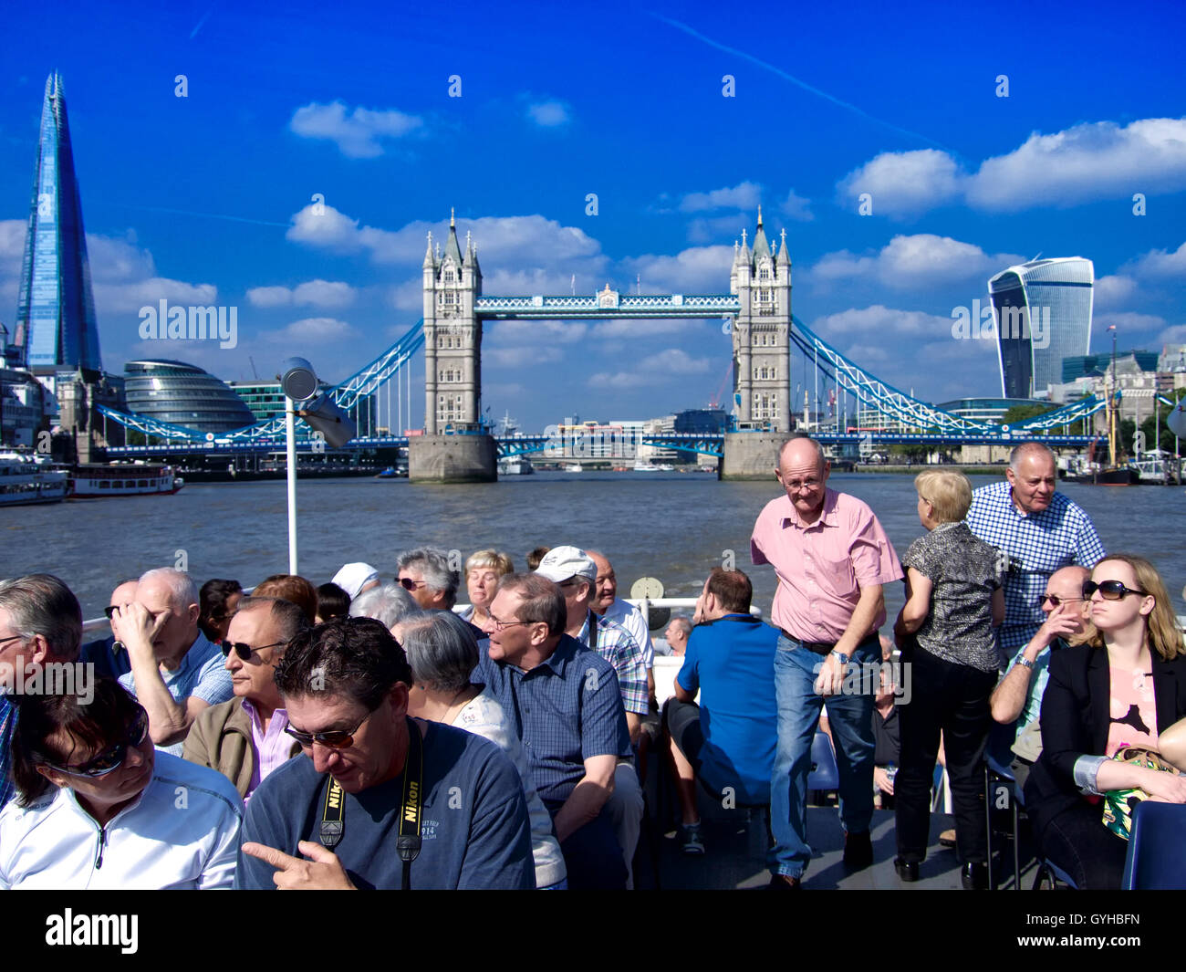 View of London Tower Bridge from Thames River on the river cruise with passengers in the foreground in the afternoon, - Stock Image