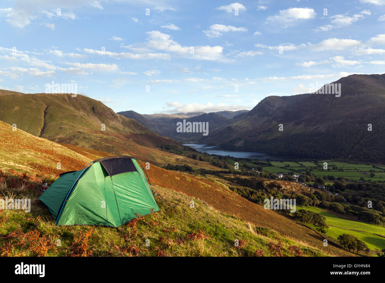 Little green tent, wild camping on Rannerdale Knotts overlooking Buttermere in the English Lake District in early - Stock Image