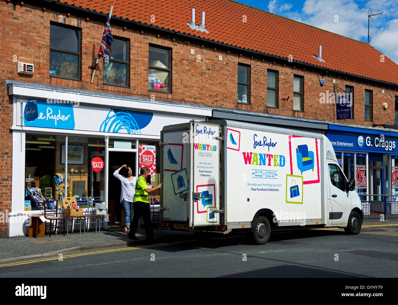 Delivery van outside Sue Ryder charity shop, England UK - Stock Image