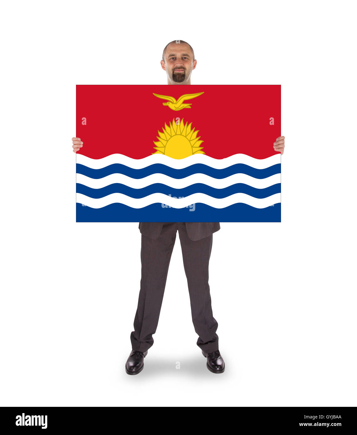 Smiling businessman holding a big card or flag - Stock Image