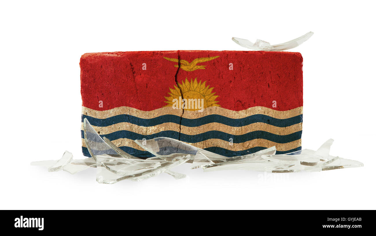 Brick with broken glass, violence concept - Stock Image