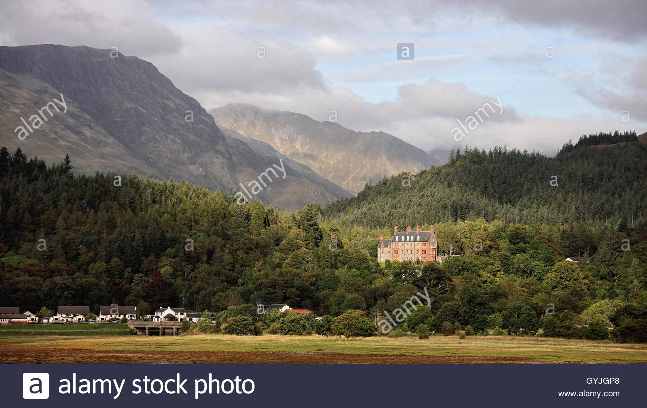 A view looking over Loch Leven from Ballachulish to Glencoe house and surrounding landscape. - Stock Image