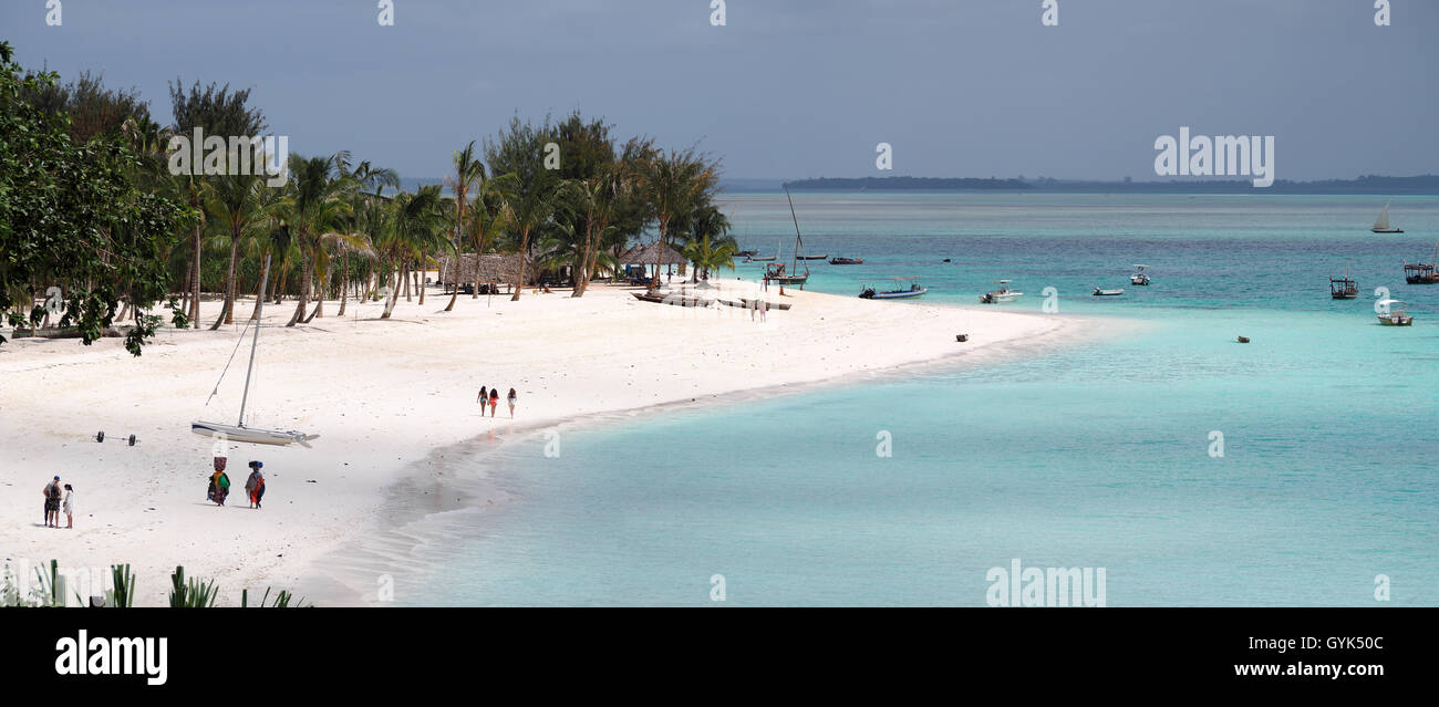 Panoramic view of the sandy white beach and bright blue sea of Nungwi beach in Zanzibar - Stock Image