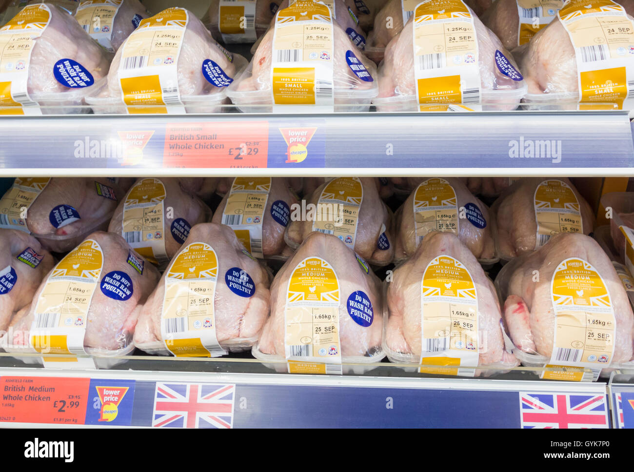 Fresh chickens with do not wash raw poultry stickers in Aldi supermarket. UK - Stock Image