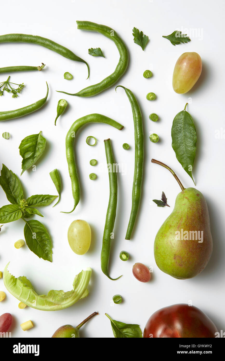 Green vegetables and fruits isolated on white. Ingredients for diet - Stock Image