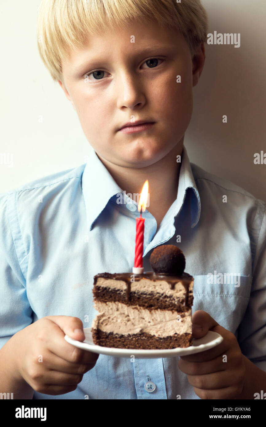 Sad Child Boy Kid Teenager With Birthday Chocolate Cake Burning Candle