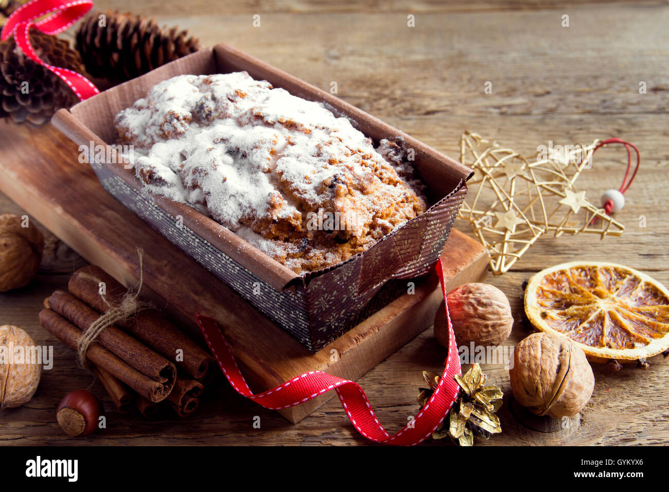 Traditional fruitcake for Christmas with decoration and ornaments - homemade Christmas pastry - Stock Image