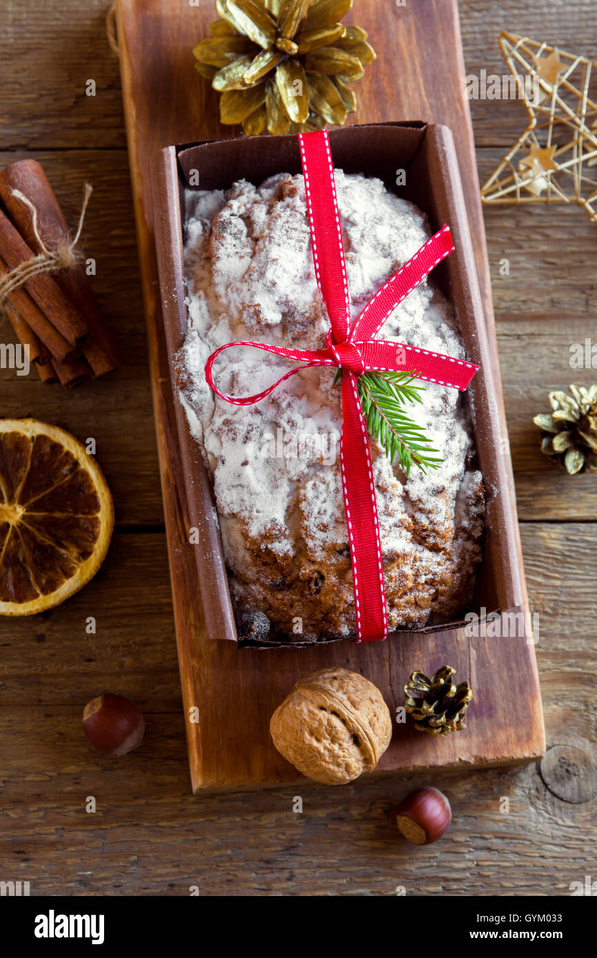 Traditional fruitcake for Christmas with decoration and ornaments - homemade Christmas pasrty - Stock Image
