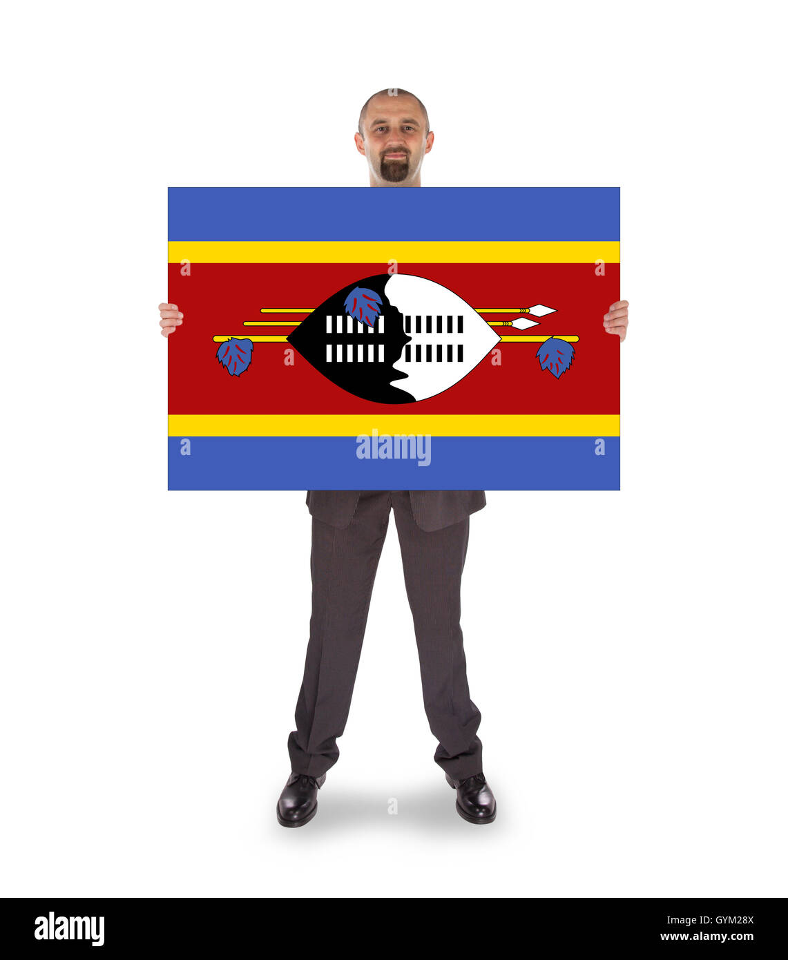 Smiling businessman holding a big card or flag Stock Photo