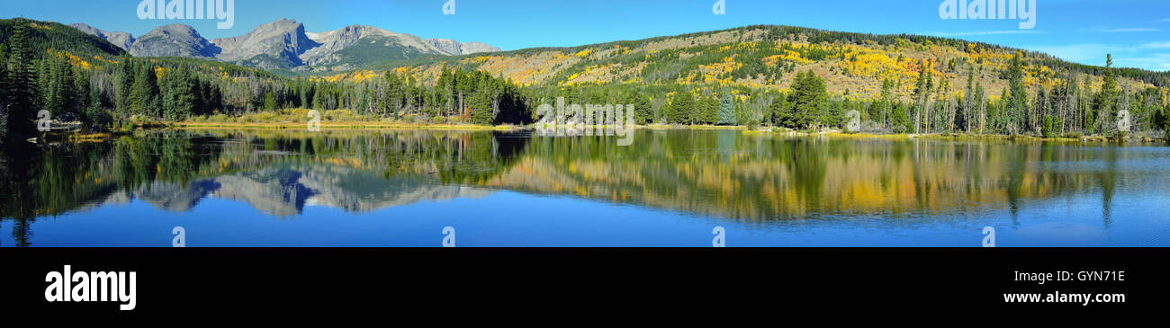 Mountains and alpine lake with reflection in the fall - Stock Image