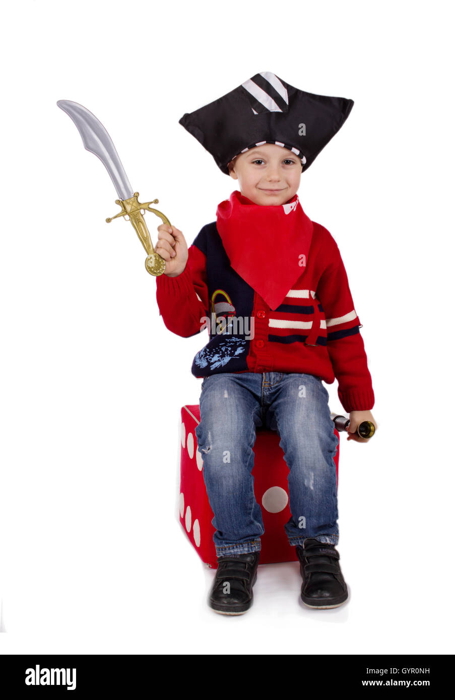 Small boy dressed like pirate holding toy sword Stock Photo