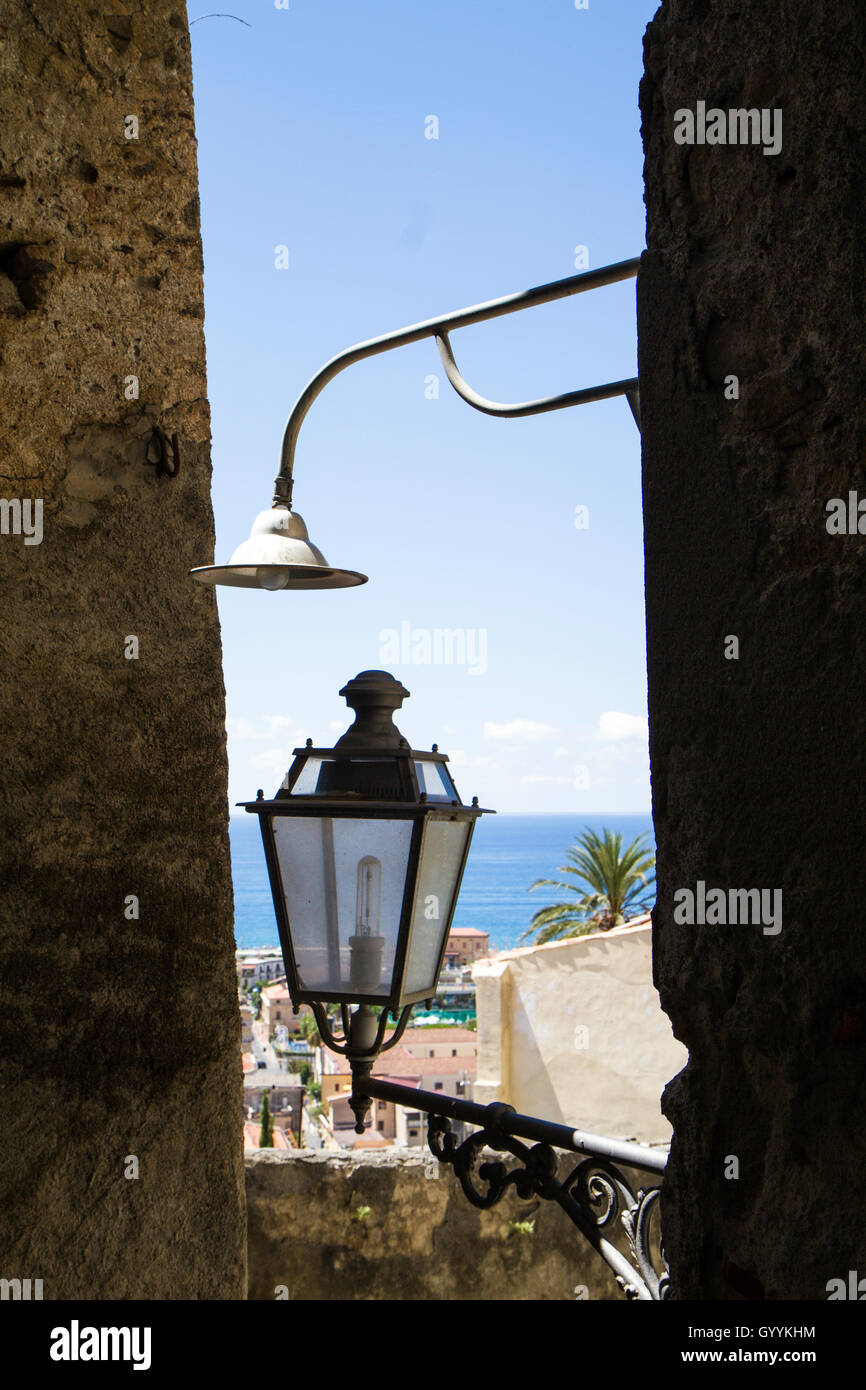 views of the Adriatic Sea through the alley of old Amantea old street lamp - Stock Image