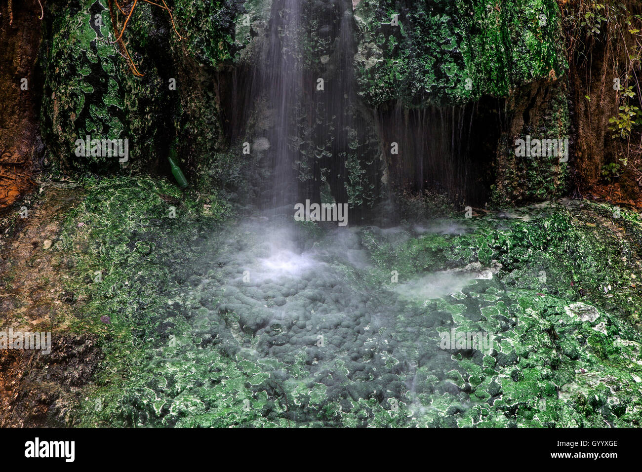 Small waterfall with green mineral deposits, hot springs of Bagni San Filippo, Castiglione d'Orcia, Tuscany, Italy Stock Photo