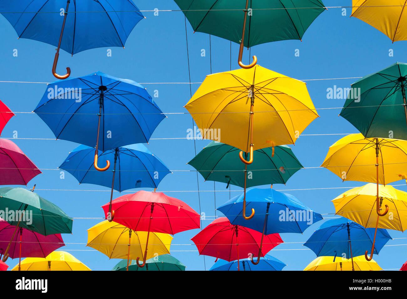 Bright umbrellas in the street - Stock Image