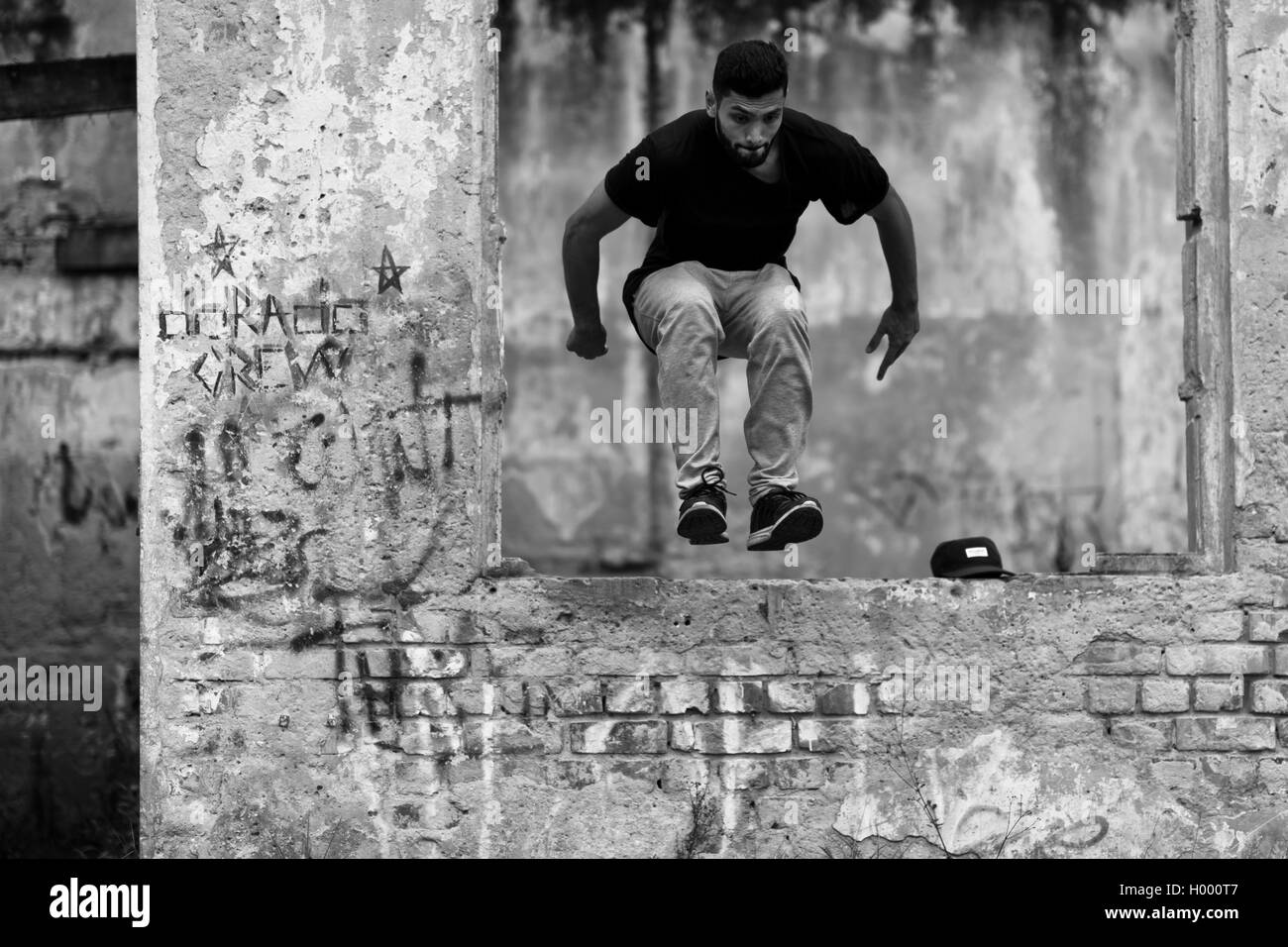 A Colombian parkour runner performs a jump during a free running training session of Plus Parkour team in Bogotá, - Stock Image