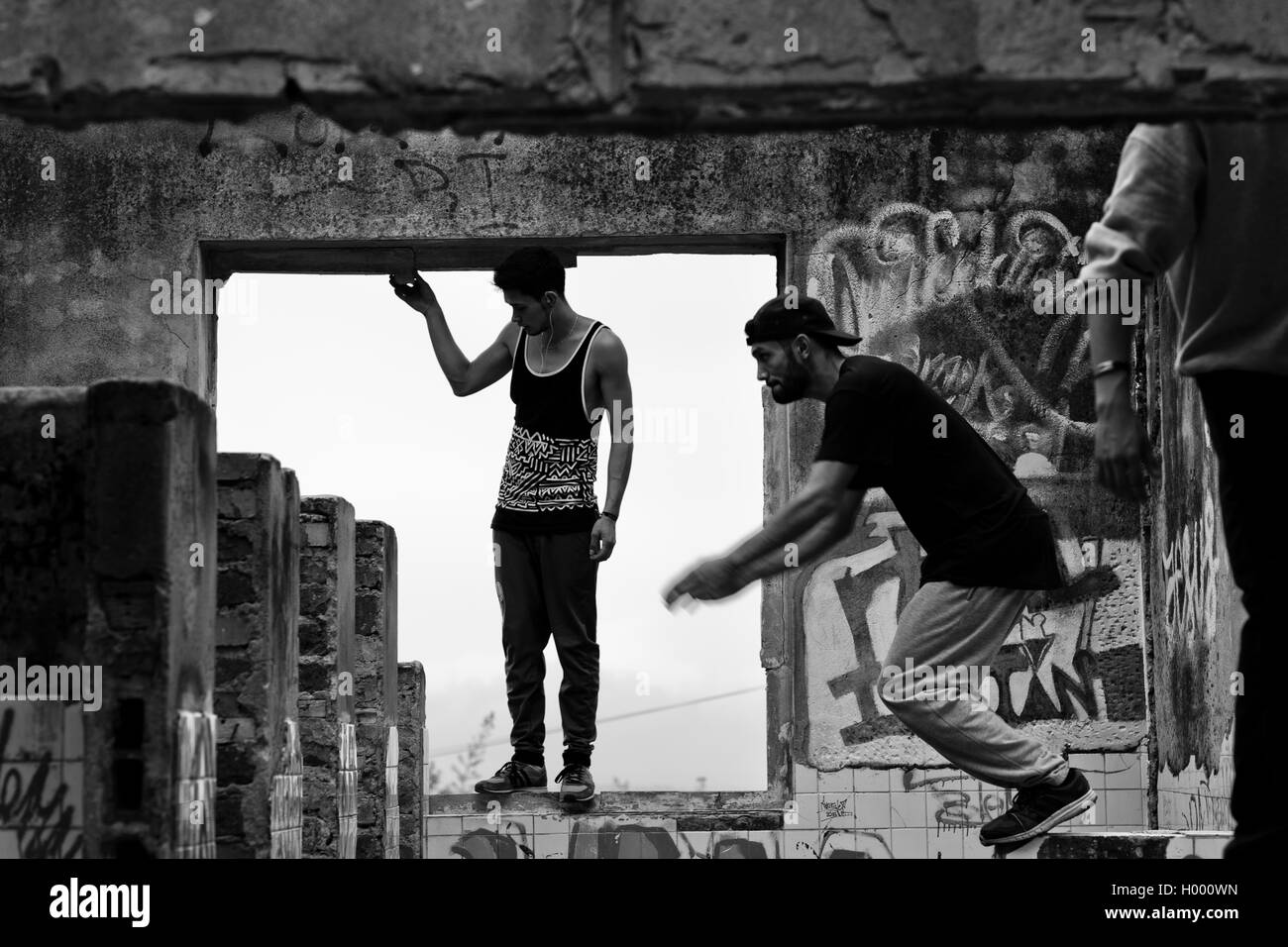 Colombian parkour athletes jump inside a house during a free running training session of Plus Parkour team in Bogotá, - Stock Image