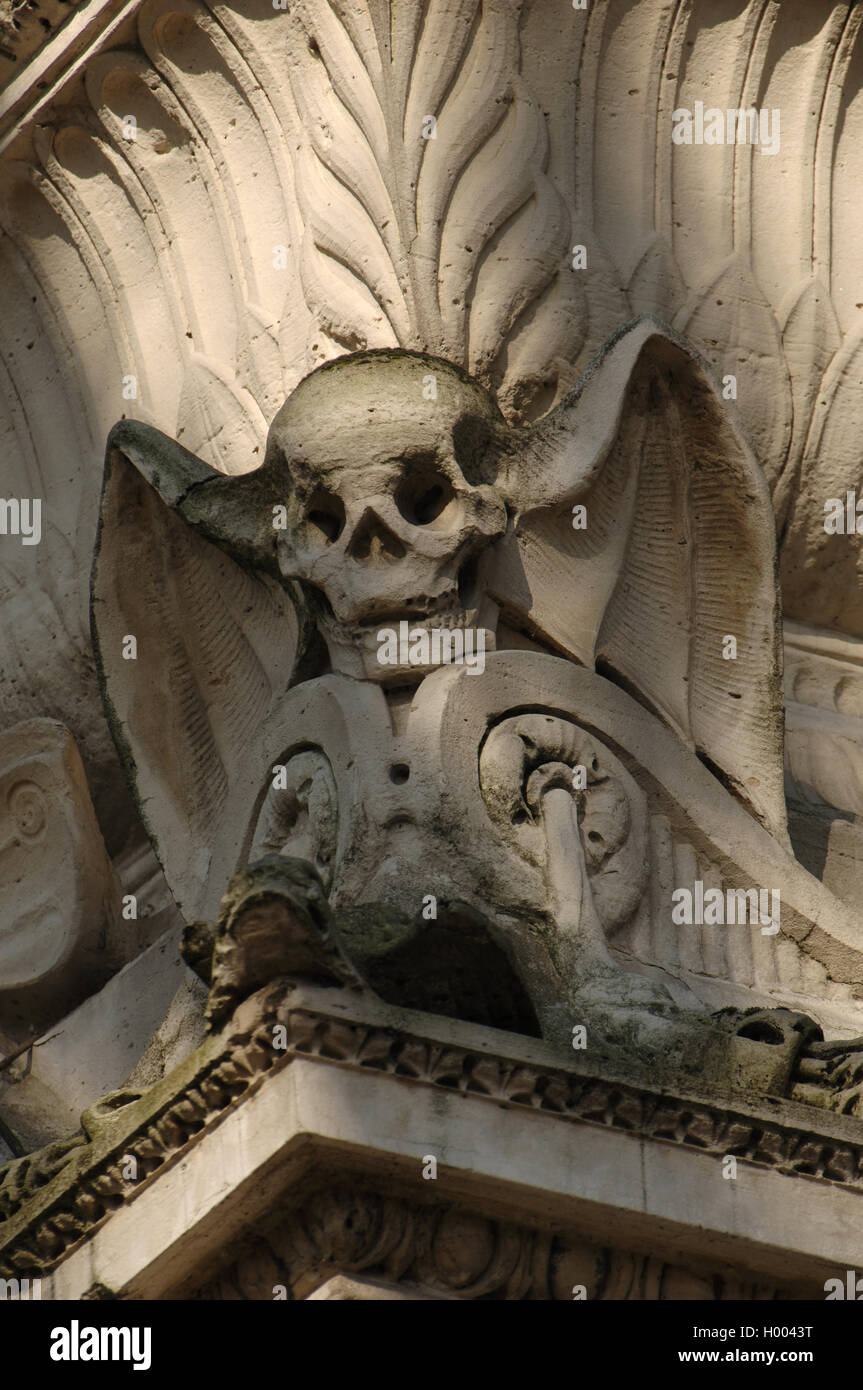 Pere Lachaise Cemetery. Winged skull. Sculptural detail of a mausoleum. Paris. France. - Stock Image