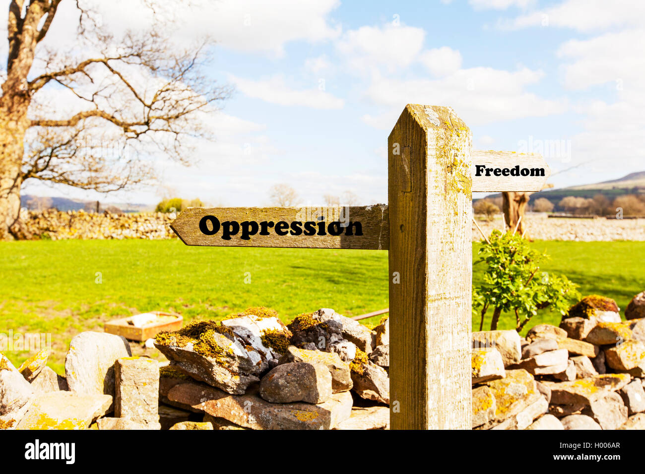 Oppression freedom Oppressed free concept sign choice choose life direction future antonym antonyms concepts signs - Stock Image