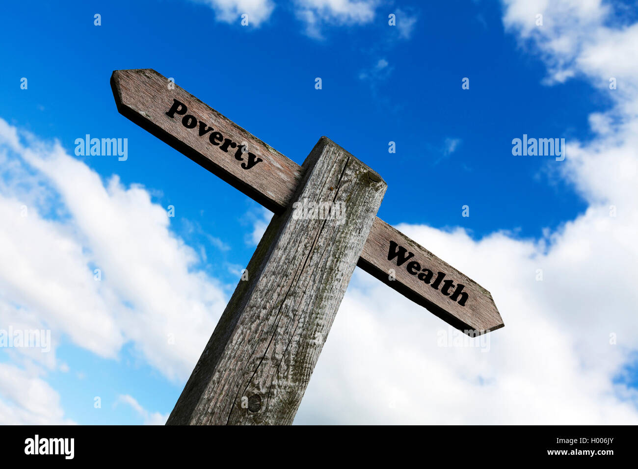 Poverty wealth concept road sign rich poor money debt haves & have nots riches choice choose direction future - Stock Image