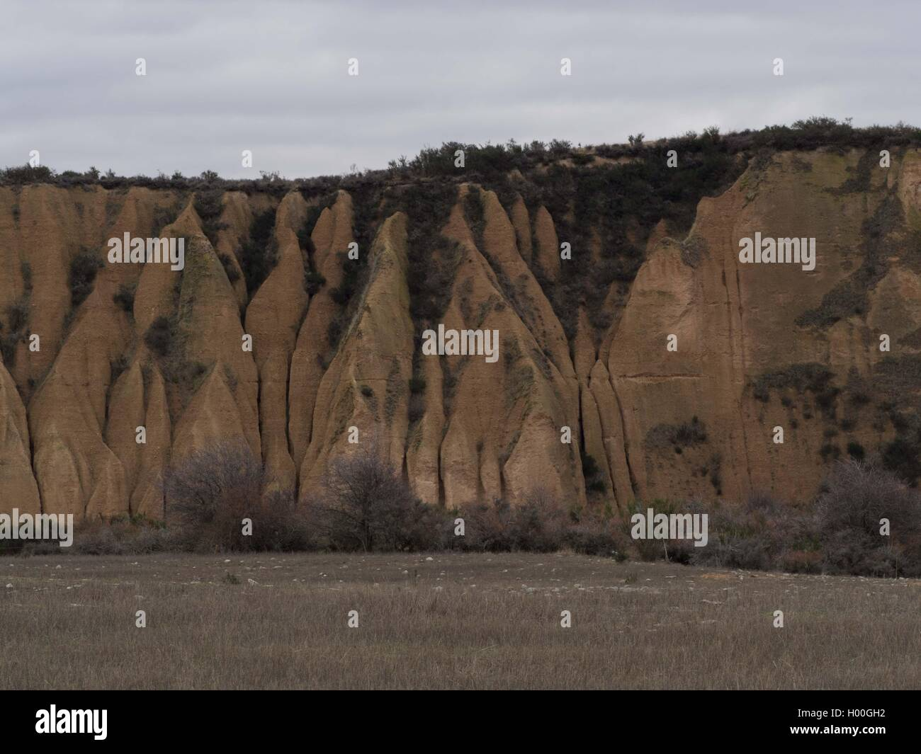 Sluiced cliffs and high heaped tailings,  Kyeburn Diggings, Manitoto, Central Otago, New Zealand - Stock Image