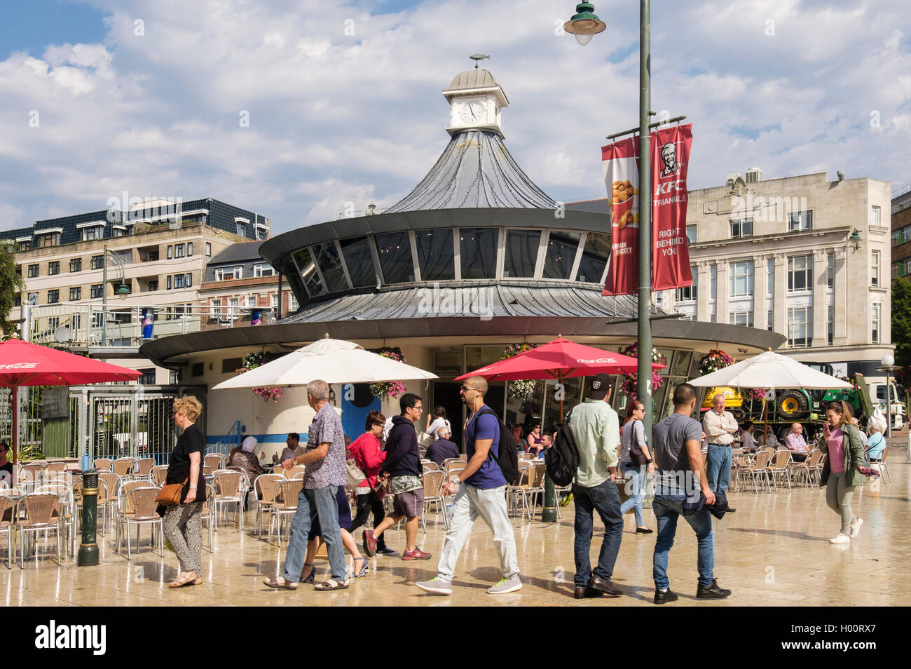Busy street scene outside with people rushing past The Obscura Cafe in The Square, Bournemouth, Dorset, England, Stock Photo