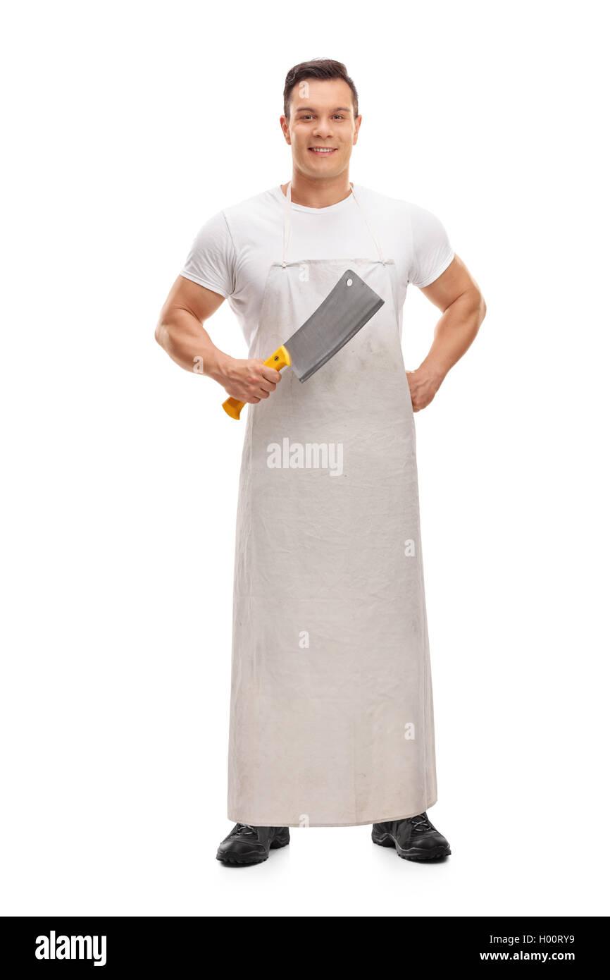 Joyful butcher holding a cleaver isolated on white background - Stock Image