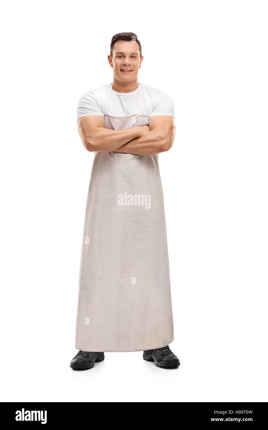 Young butcher posing and looking at the camera isolated on white background - Stock Image