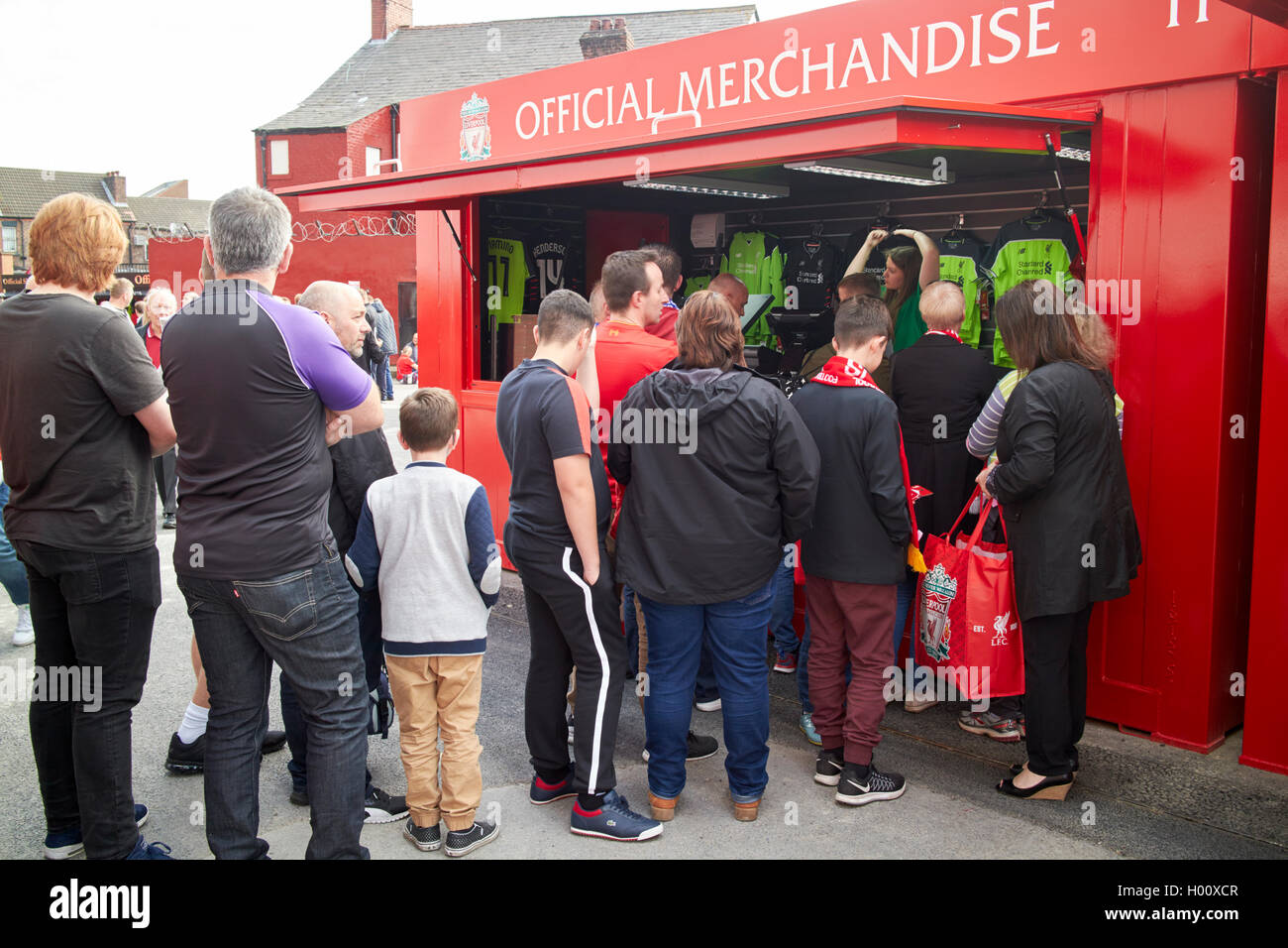 queues of fans at official merchandise stall at Liverpool FC anfield stadium Liverpool Merseyside UK - Stock Image