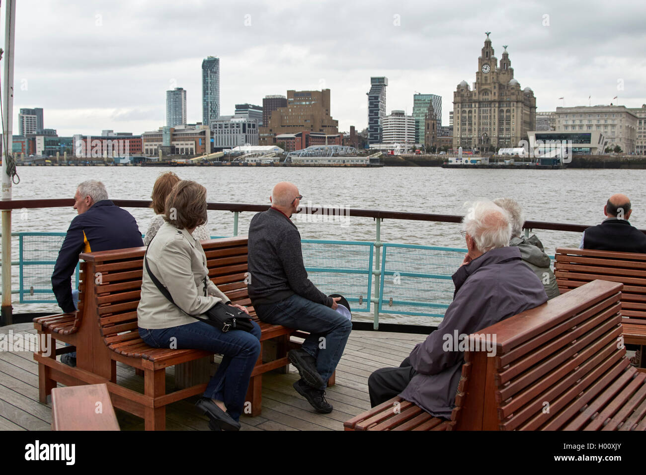 passengers on observation deck of mersey ferries ferry cross the mersey Liverpool Merseyside UK - Stock Image