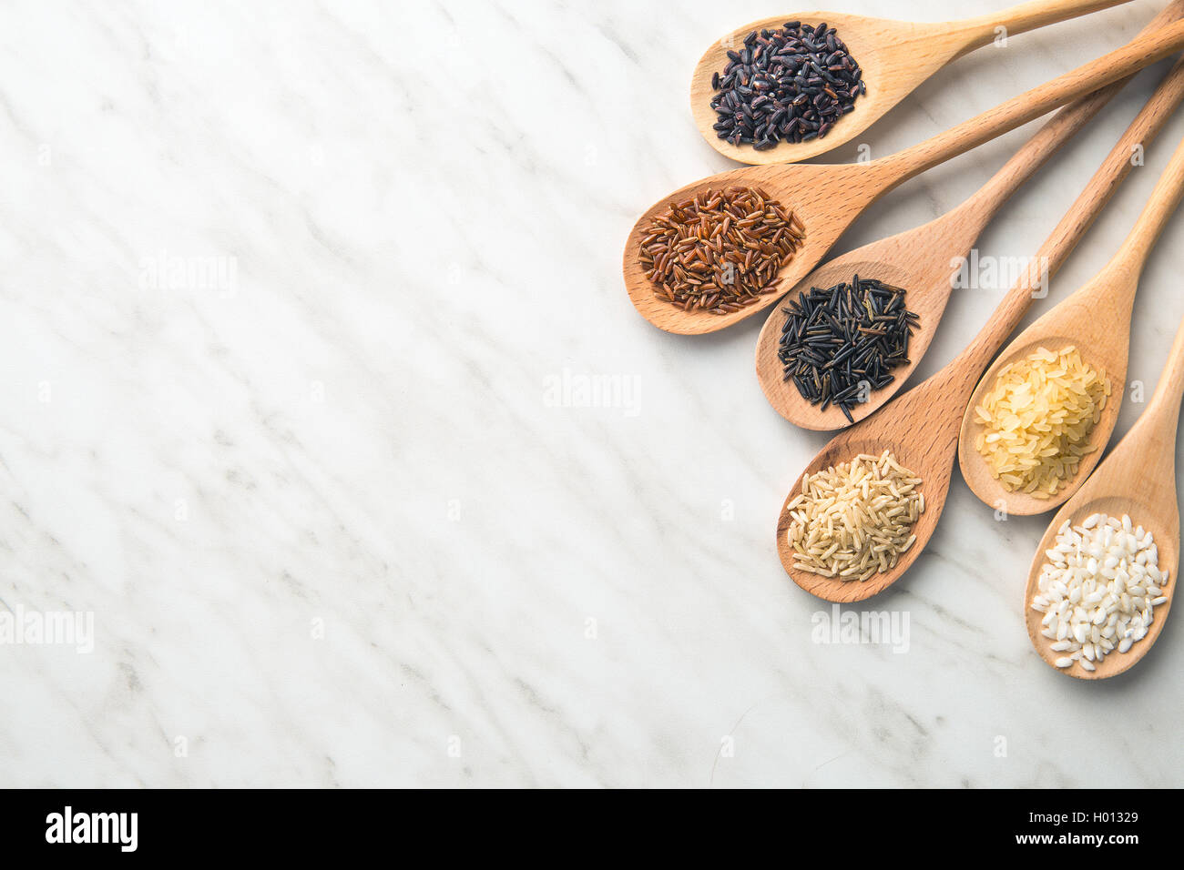 Different rice varieties on kitchen table Stock Photo: 120496945 - Alamy