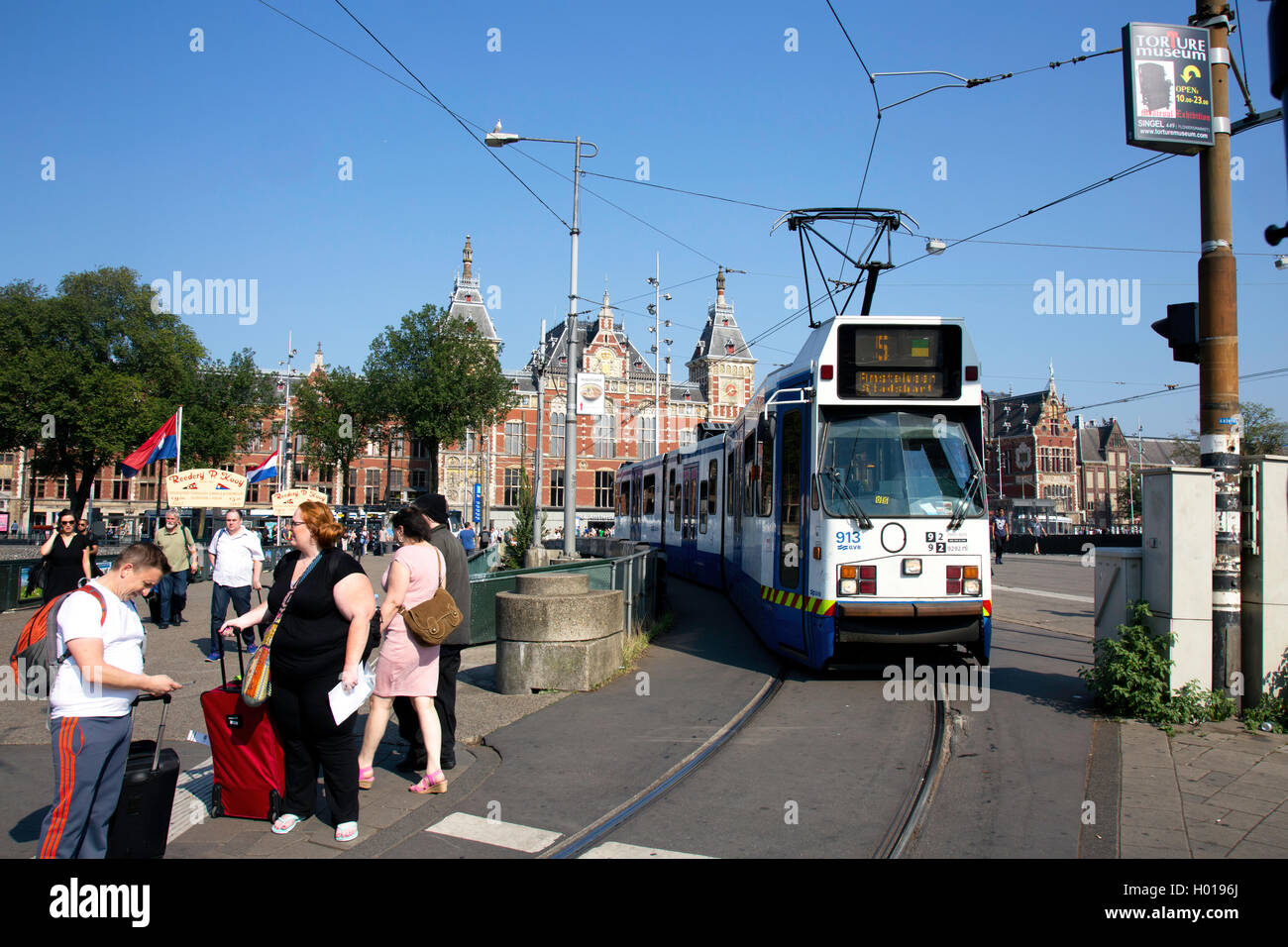 A Tram outside Amsterdam Centraal Station - Stock Image