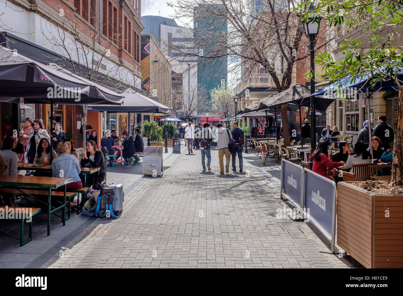 Diners and tourists enjoying the sunshine in Leigh street Adelaide Australia - Stock Image
