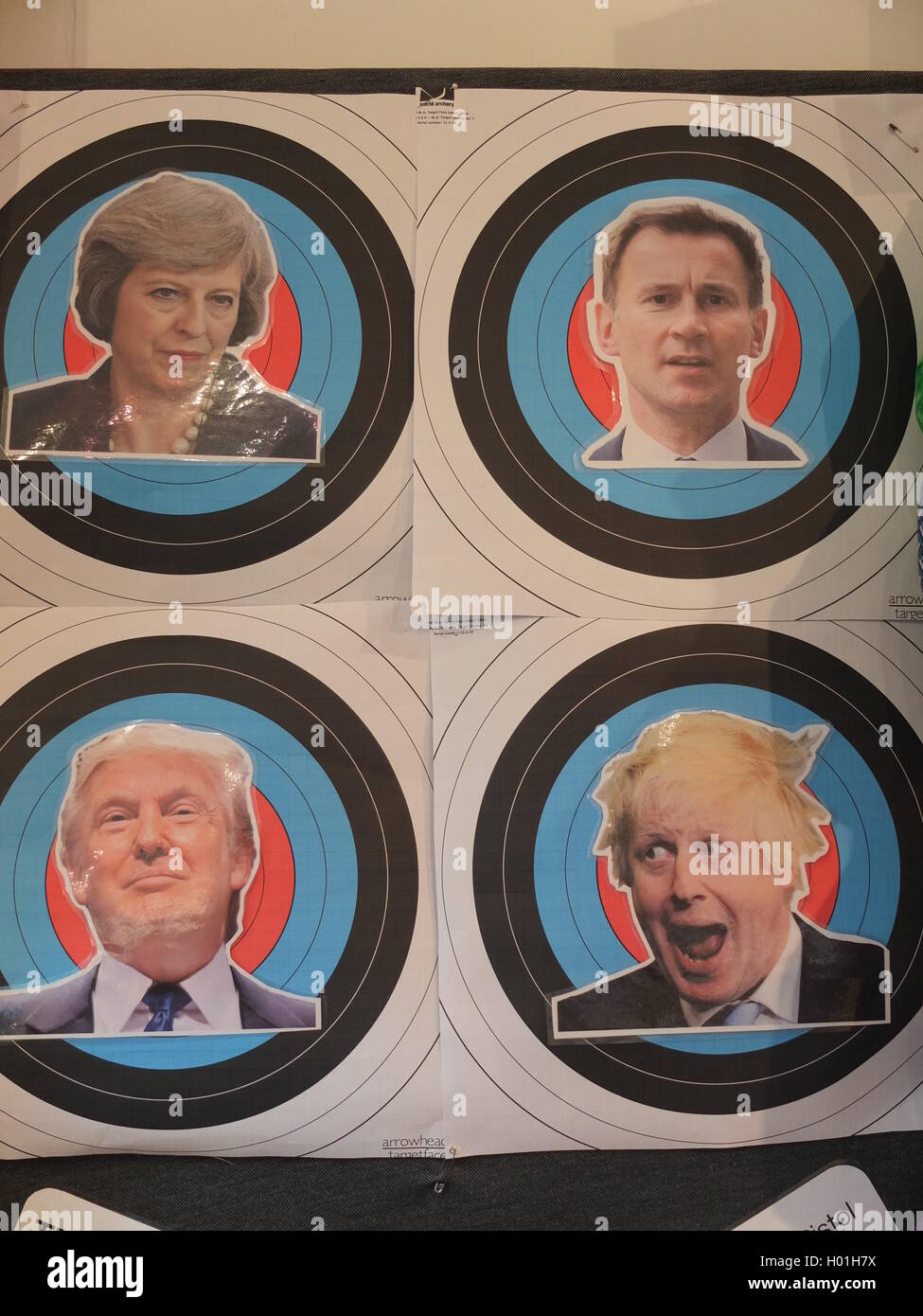 A Sheffield shop invites customers to try out ping pong ball crossbows on targets of unpopular politicians - Stock Image
