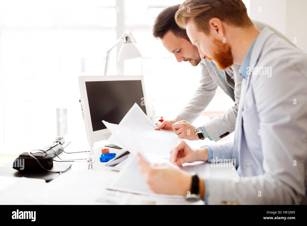 Colleagues working in office and brainstorming - Stock Image