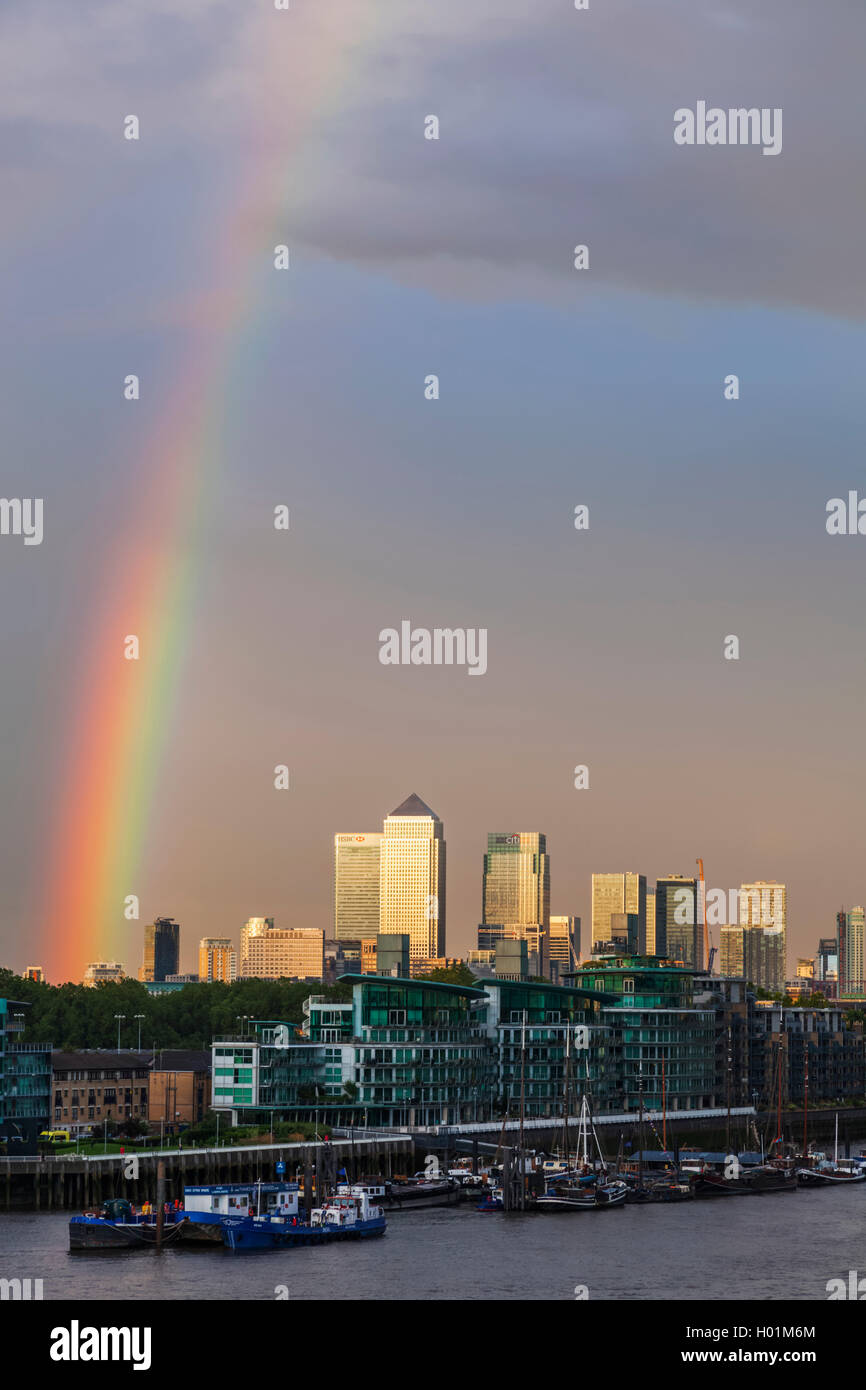England, London, Rainbow over The Thames River and Docklands - Stock Image