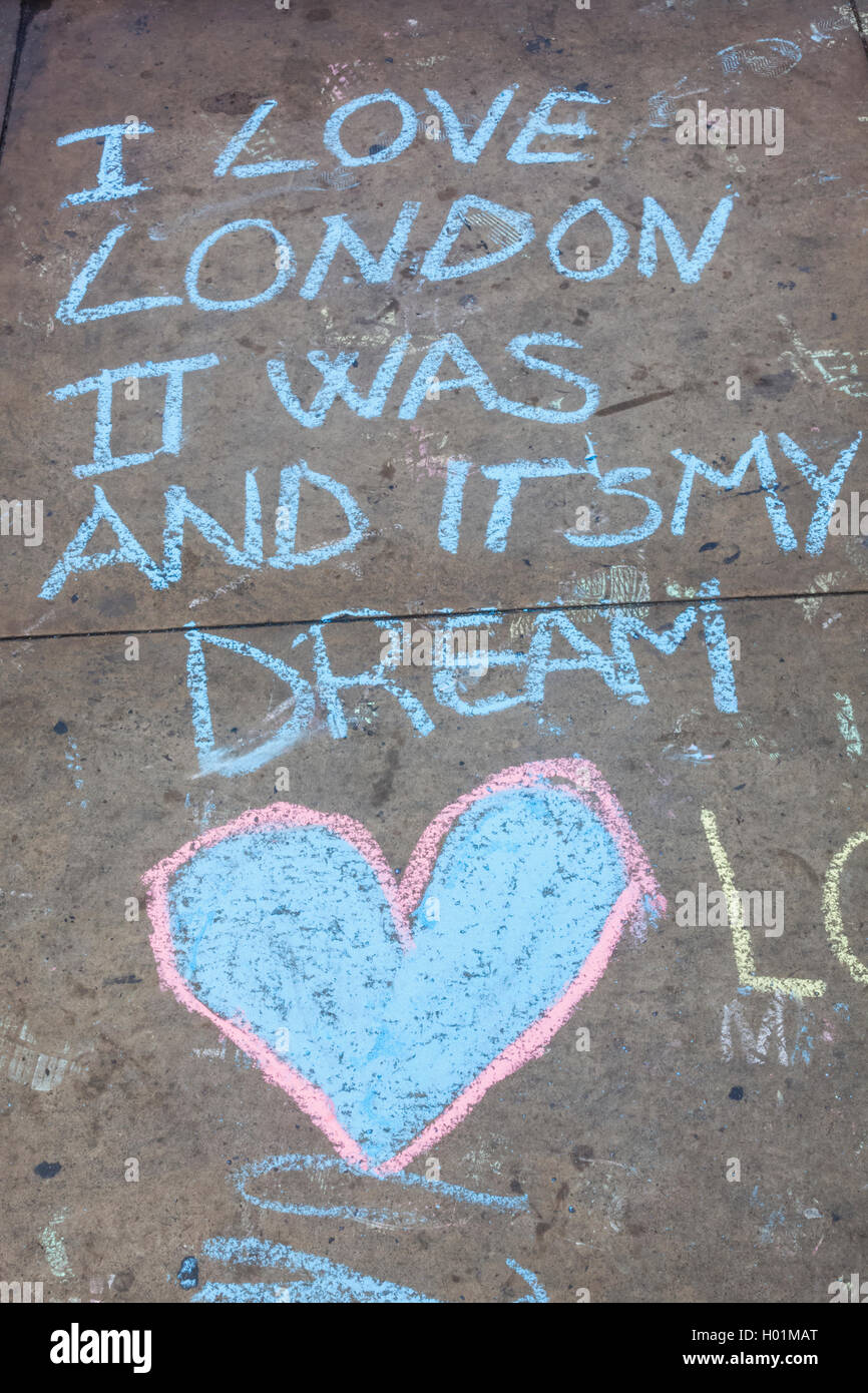 england london piccadilly circus chalk writing on pavement stock