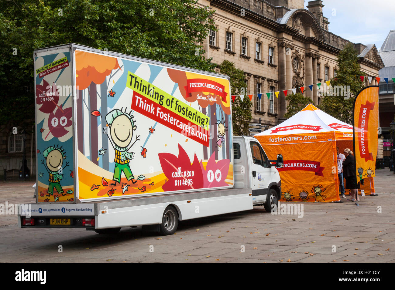 Thinking of Fostering, foster carers wanted.  A advertising promotional travelling road show with road trailer and - Stock Image