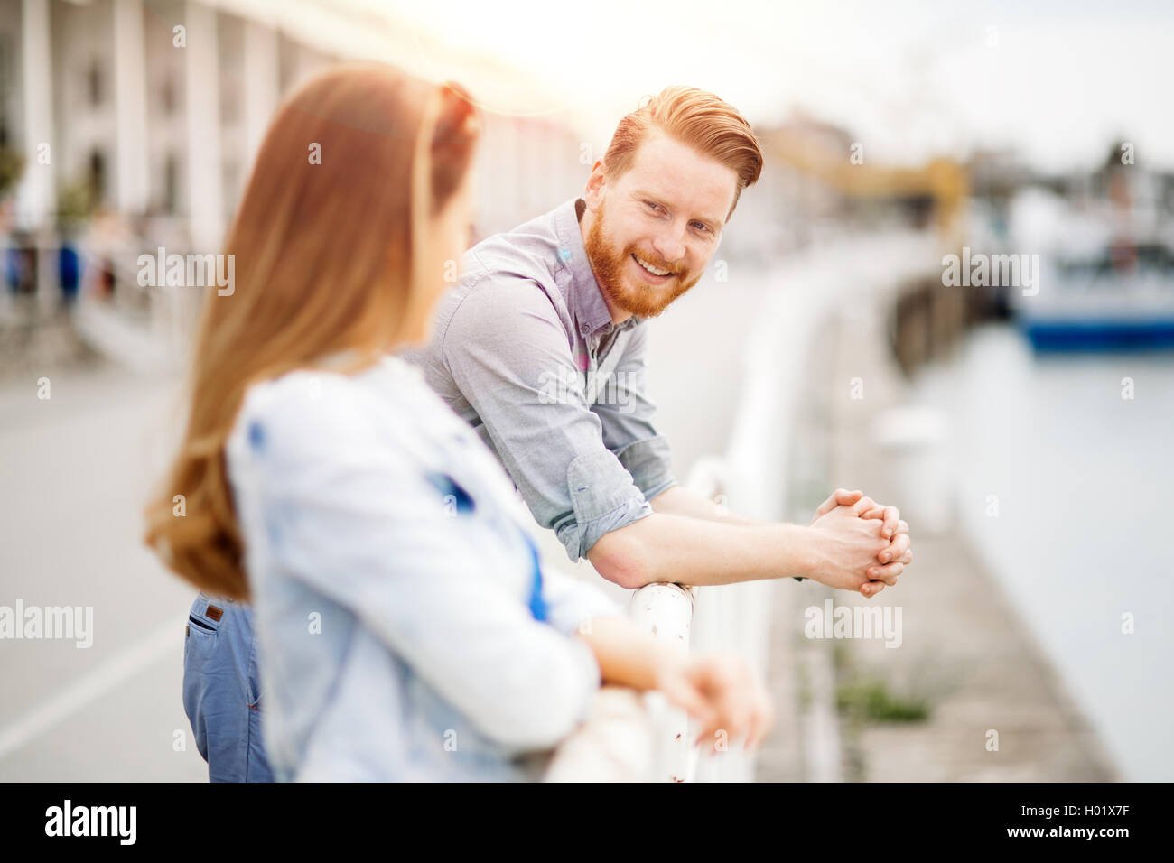 Romantic couple flirting and dating outdoors - Stock Image