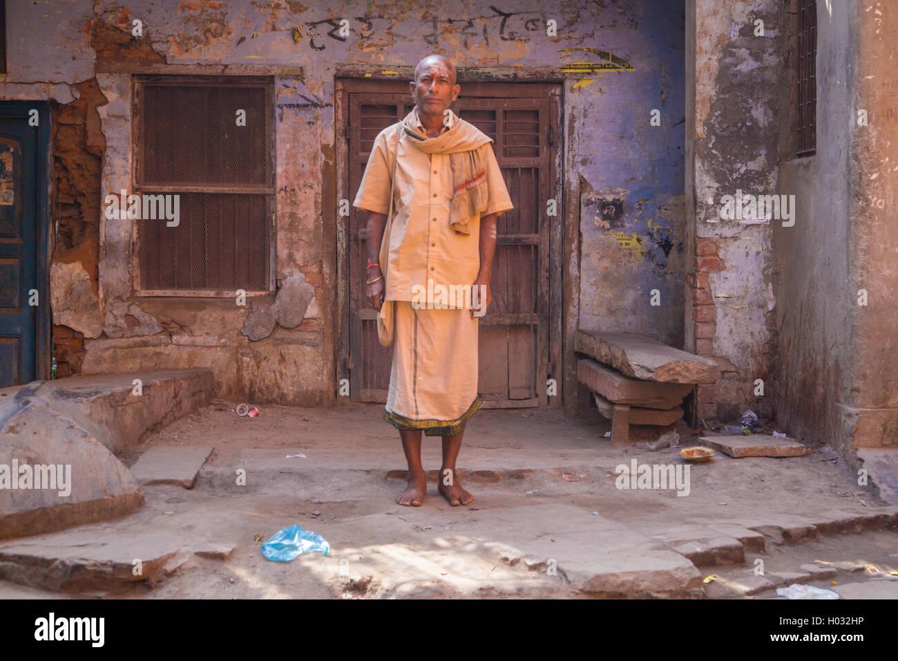 f7cca193f2 VARANASI, INDIA - 21 FEBRUARY 2015: Pilgrim dressed in lungi, shirt and  scarf