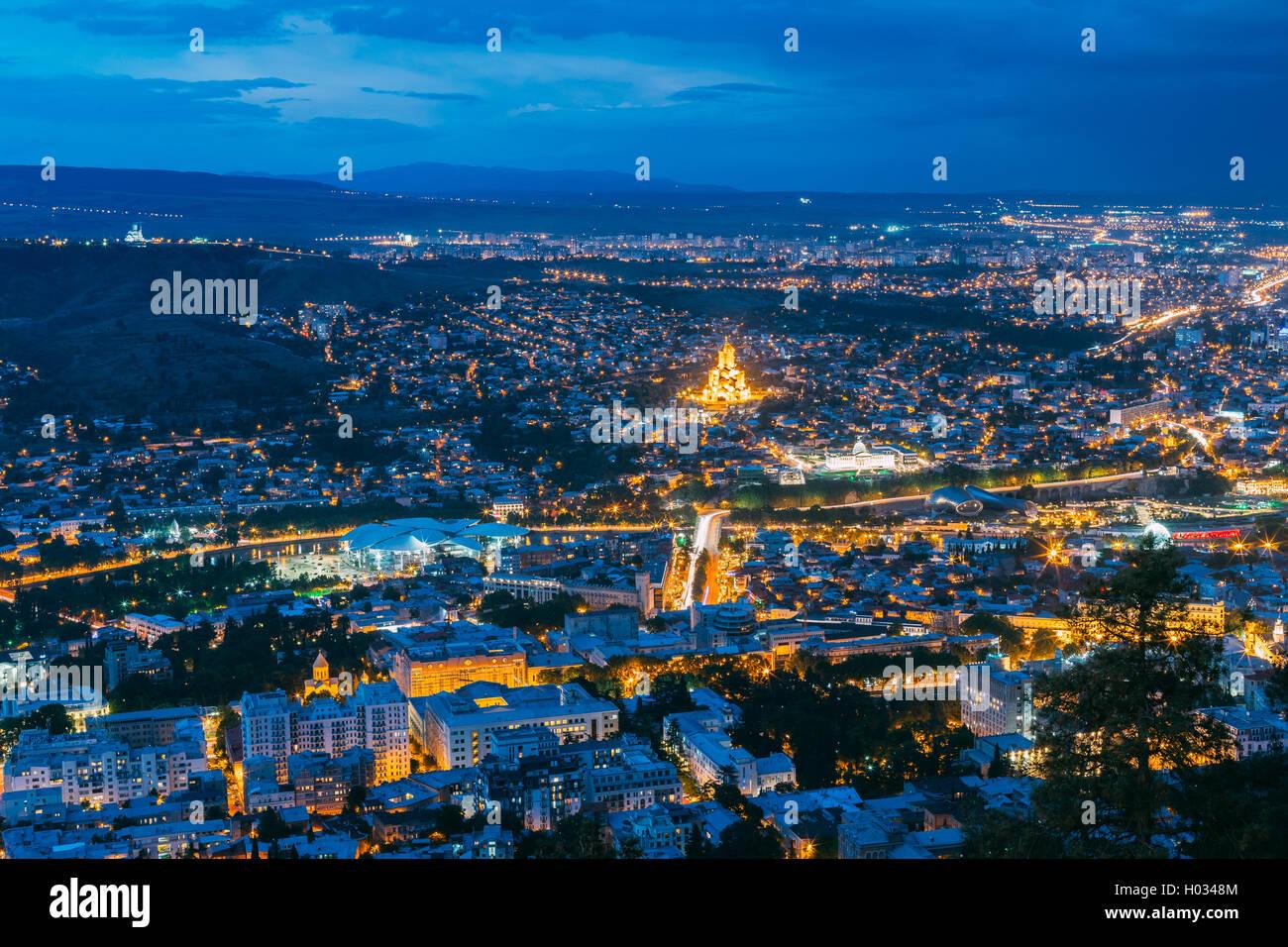 Tbilisi, Georgia. Aerial Cityscape View Of Capital In Evening Illimination, Modern Uptown, Baratashvili Bridge, - Stock Image
