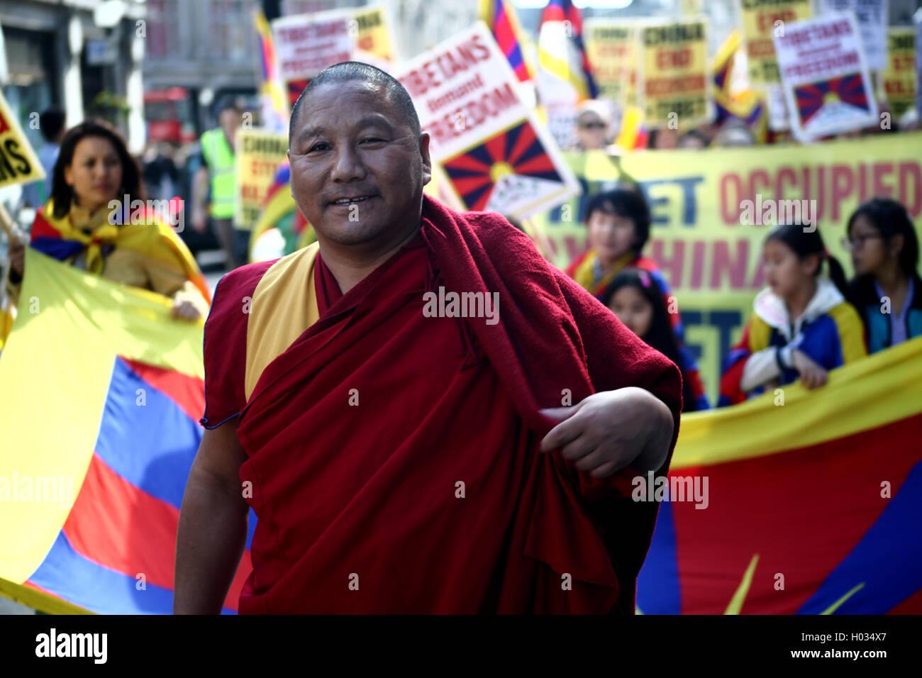 Tibetan monk at the demonstration for free Tibet, London, UK - Stock Image