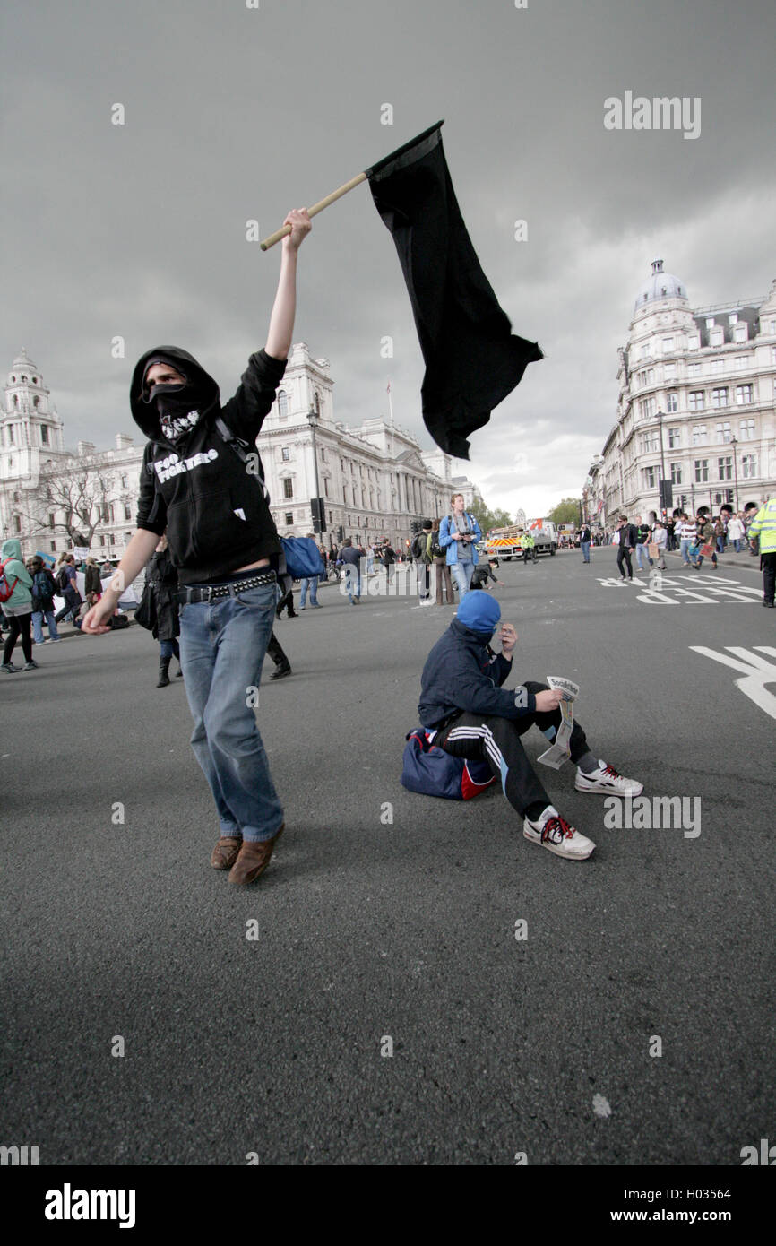 Anarchist at a demonstration with a black flag, London, UK. - Stock Image