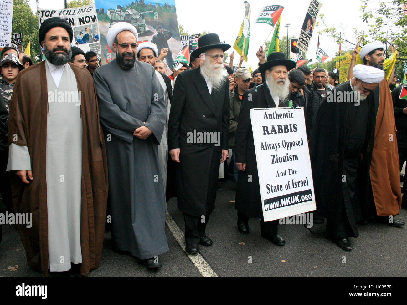 Iranian Shia Muslim clerics together with orthodox Jews marching during Al-Quds Day, London, UK. - Stock Image