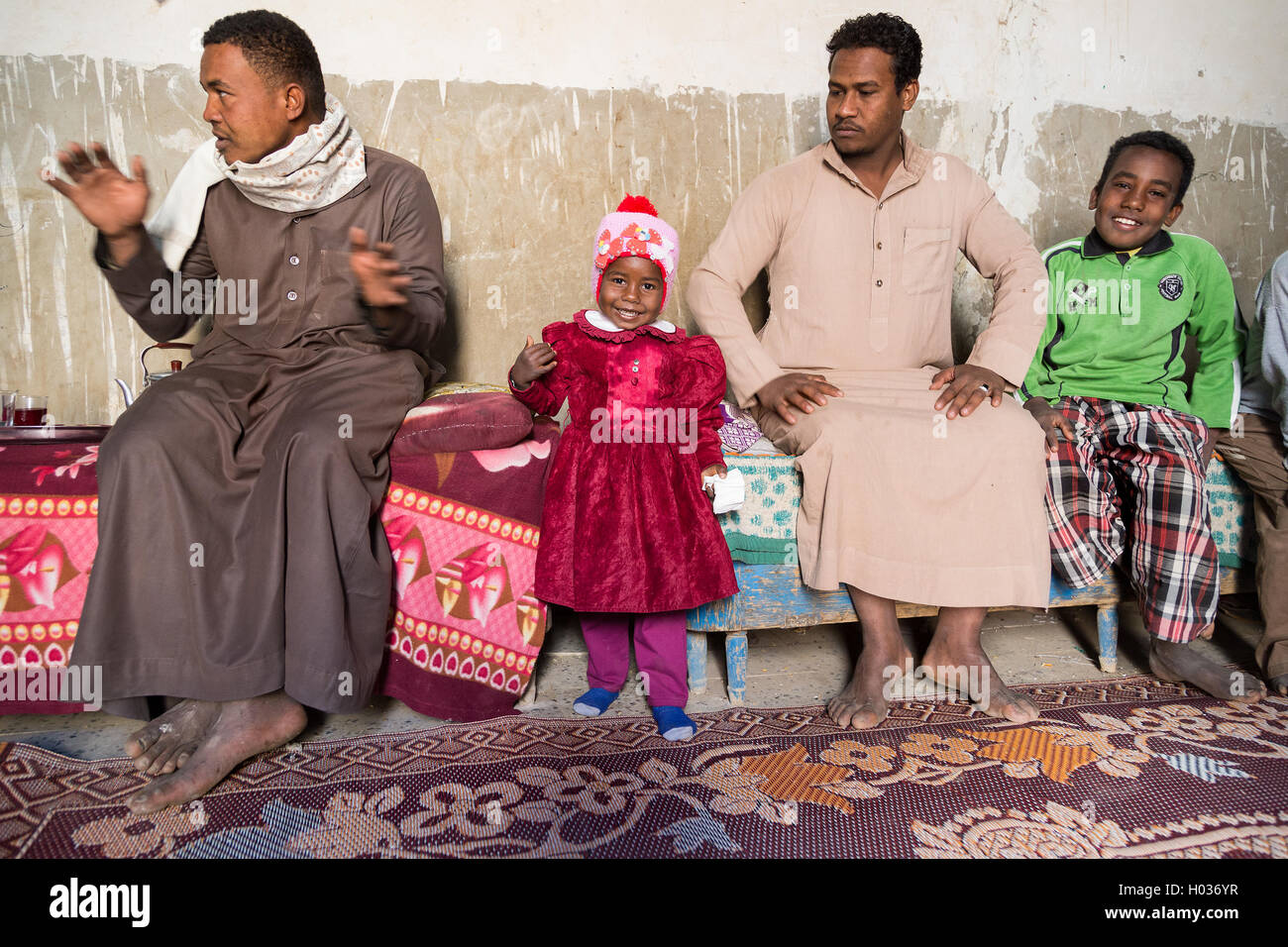 ASWAN, EGYPT - FEBRUARY 7, 2016: Local family from Nubian village on the Nile in their home. Stock Photo
