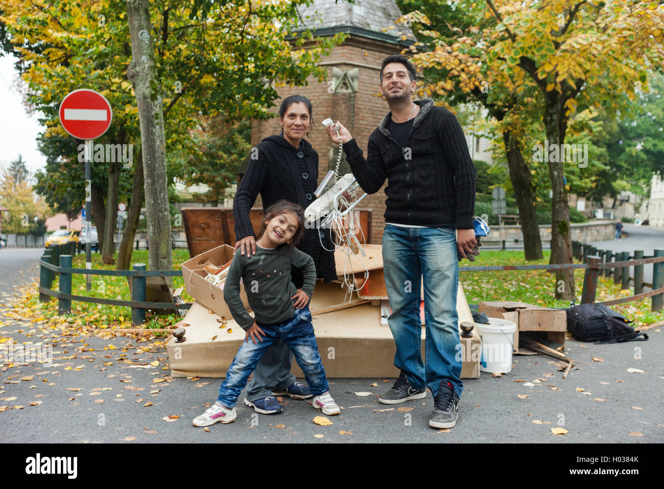 ZAGREB, CROATIA - OCTOBER 14, 2013: Roma family fooling around for camera at garbage dump. - Stock Image