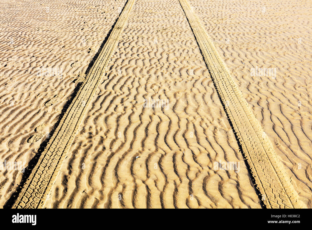 Wheel tracks in the the sand dunes. - Stock Image