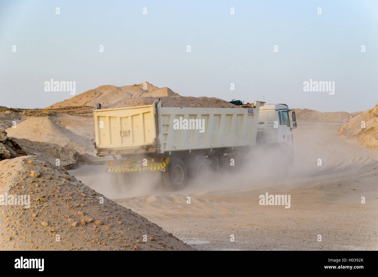 Truck passing into a sand quarry in the desert of Qatar - Stock Image