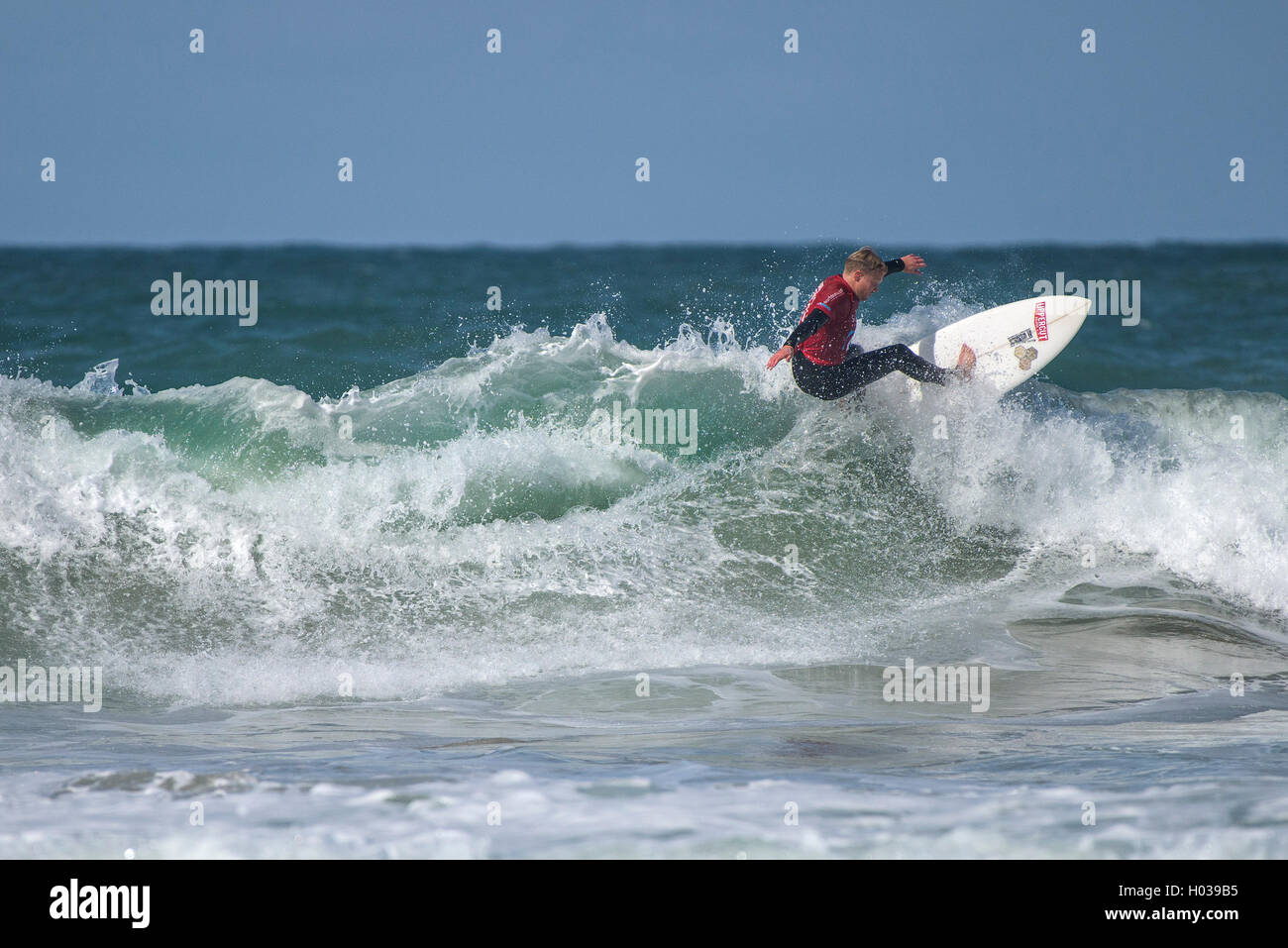 A competitor in spectacular surfing action at the Surfing GB Inter-Clubs Surfing Competition at Fistral in Newquay, - Stock Image