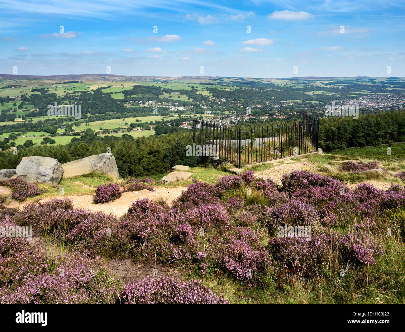 View over Ilkley from the Swastika Stone at Woodhouse Crag Ilkley Moor West Yorkshire England Stock Photo