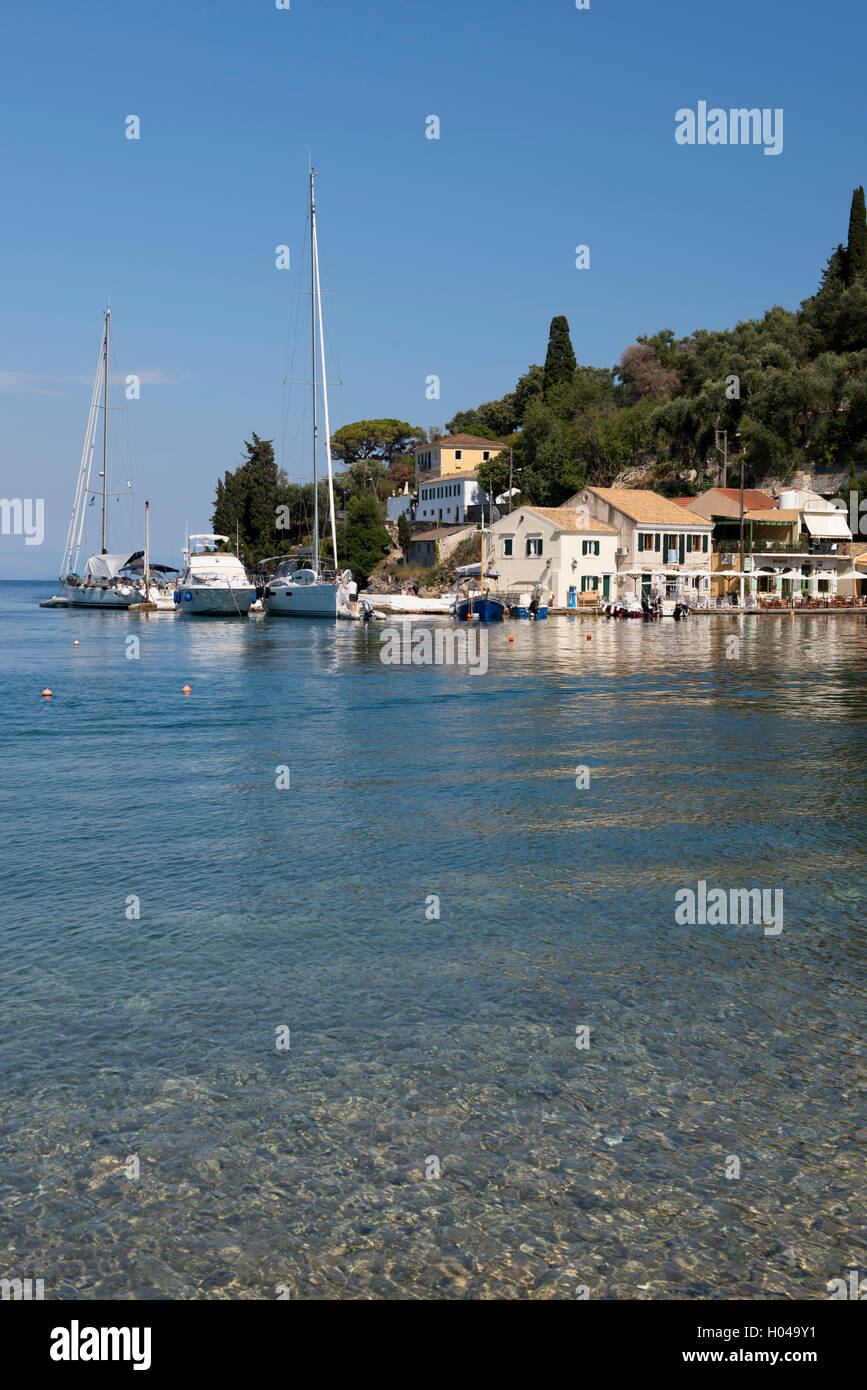 The picturesque harbour of Loggos on the East coast of Paxos, The Ionian Islands, The Greek Islands, Greece, Europe - Stock Image